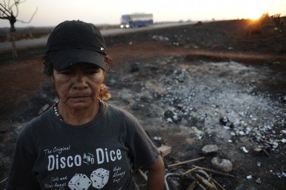 Guarani Kaiowa Indian woman Damiana Cavanha, stands in front of her hut destroyed by a fire near Dourados